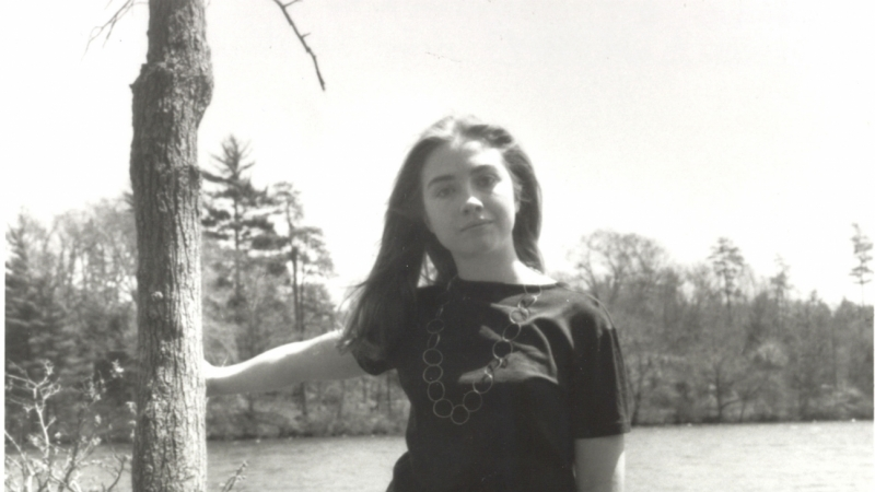 Hillary Rodham '69 poses by Lake Waban on the Wellesley College campus