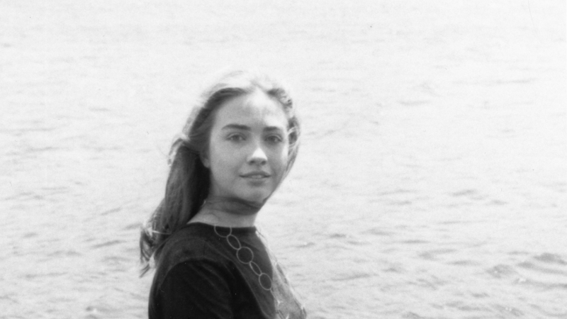 Hillary Rodham '69 at Lake Waban's edge on the Wellesley College campus