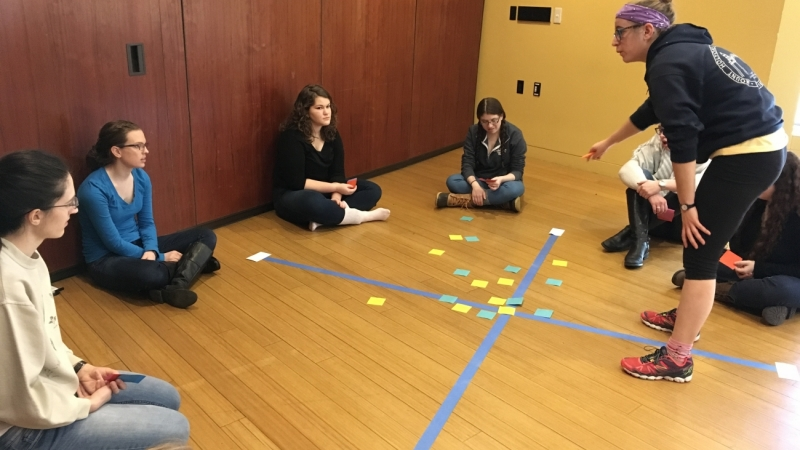 students work together on a leadership building exercise