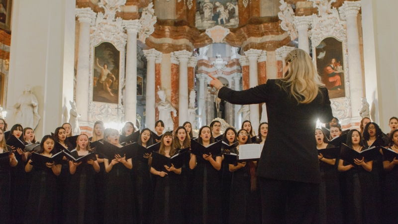 choir performing in front of director
