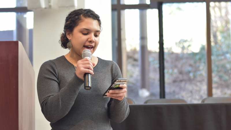 A student speaking with a microphone
