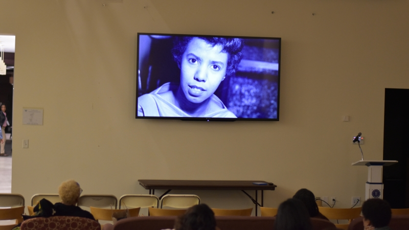 A TV screen mounted on the wall for the Ethos screening