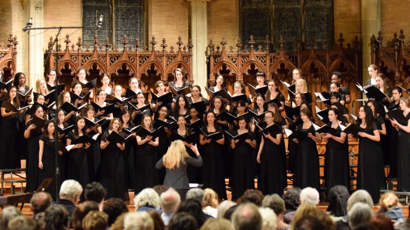 choir performing in Wellesley Houghton Chapel
