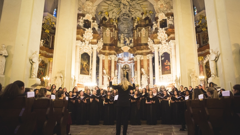 wide shot of choir performing in elegant church