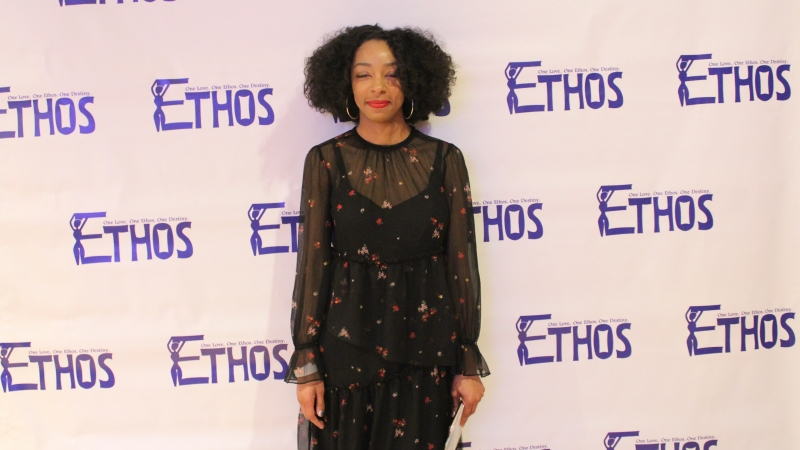 Student standing in a dress for the Ethos gala