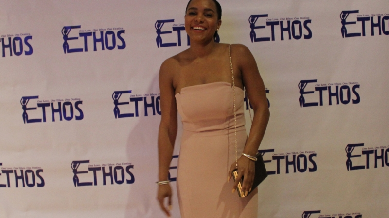 A student standing in a dress for the Ethos gala