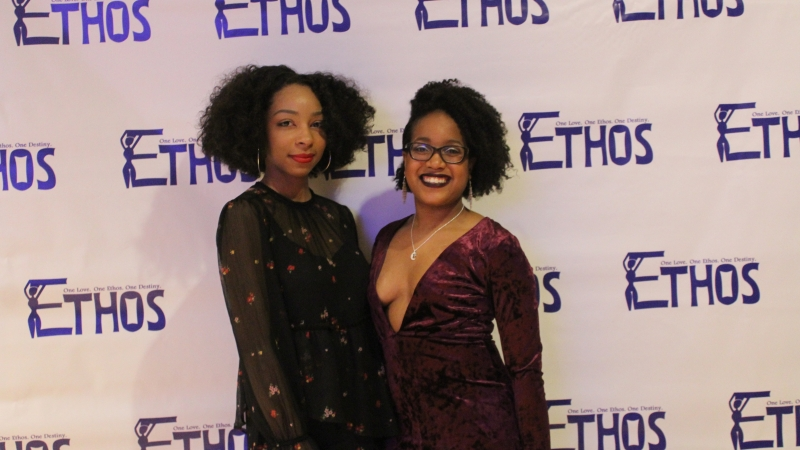 Two students standing in dresses for the Ethos gala