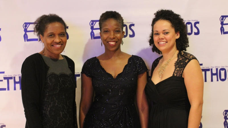 Three students standing in dresses for the Ethos gala