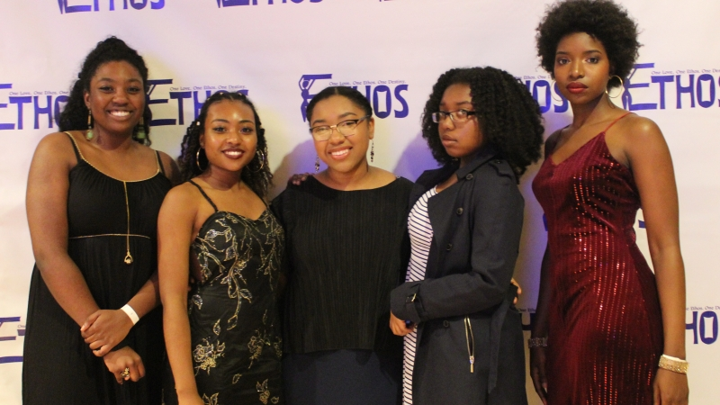 Five students standing in dresses for the Ethos gala