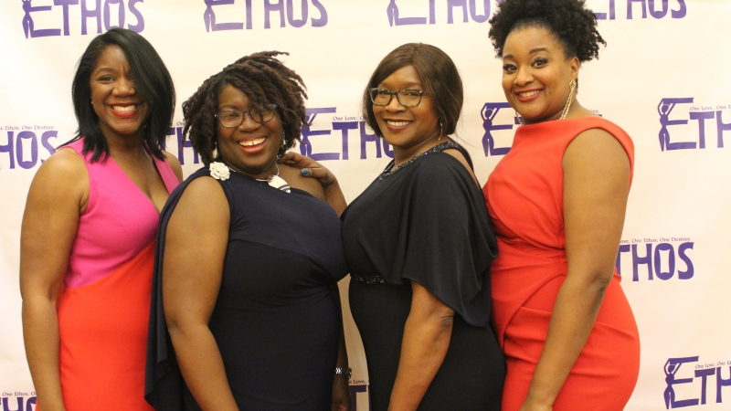 Women posing for the Ethos gala