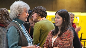 older and younger alumnae chat at symposium