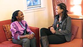 Wellesley's MasterCard Foundation Scholars, Martha Aywa and Refilwe Kotane, talk together in Harambee House.