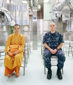 An-My Lê, Patient Admission, US Naval Hospital Ship Mercy, Vietnam, 2010. Archival pigment print, 40 x 56 1/2 inches (101.6 x 143.5 cm). Edition of 5. Courtesy Murray Guy.