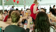 seniors around table raise glasses to toast