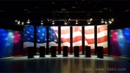 Political debate stage with quoted text overlaid