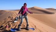 Kathy Long on sandboard in desert