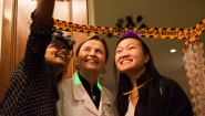 """President Bottomly takes a """"selfie"""" with trick or treating students"""