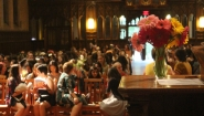 Flowers in the foreground, Houghton Chapel filled for Flower Sunday