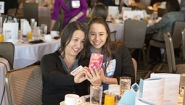 Leilani Stacy '18, a finalist in a national essay contest, snaps a picture with her mother at a gathering hosted by the contest's sponsoring organization, Womenetics.