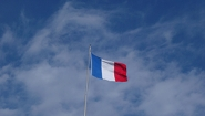 The French flag against a blue sky