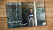 A postcard on a table shows Catherine Puga '17 in Rabat Morocco