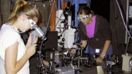 two students work in Welleslsey physics lab