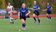 Wellesley field hockey players take ball upfield