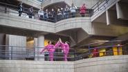 dancers in pink on science center walkway