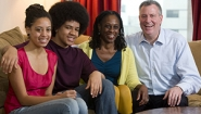 McCray posed with de Blasio and their two teenage children