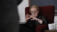 Secretary Albright seen from behind a presenter