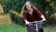 Ashley Funk rides bike on a fall day