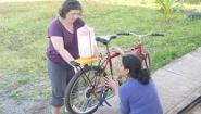 Amy Banzaert and student work on bicycle
