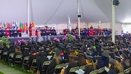 full audience under the commencement tent
