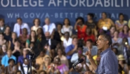 "Obama on campaign trail with ""College Affordability"" sign behind him"