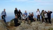 Bryan Burns and 11 students atop rocky peak in Crete