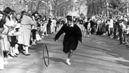 Amalya Kearse '59 winning hooprolling race in 1959