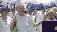 silver-haired purple class alums march in parade