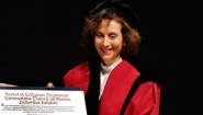 Peggy Levitt holding honorary PhD diploma