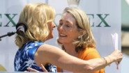 Chris Evert embraces Brown Grimes at ceremony