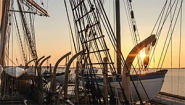 sunrise behind rigging of 1841 whaling ship