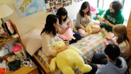students playing cards in dorm room