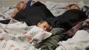 Getty image: children sleeping in refugee center