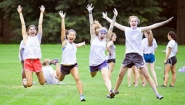 four students leaping and laughing