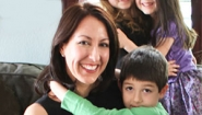 Erin Giglia holding son in her lap