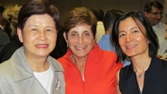 Lois Juliber '71 (center) with MasterCard Foundation CFO Peggy Woo (left) and Reeta Roy, president and CEO (right).