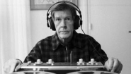 John Cage using reel-to-reel recorder