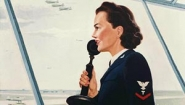 recruiting poster from WWII showing woman in control tower