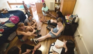 student group in conversation in dorm room