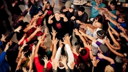 Artists from the 2013 International Body Music Festival with Hands outstretched