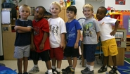 preschoolers pose in their school